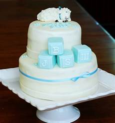 marzipan christening cake with sleeping and baby blocks