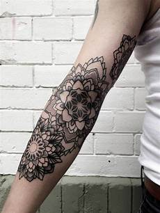 mandala flowers by philippe hernandez arm tattoos