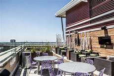 urban roof deck with round tables hgtv