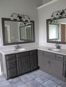 this cool gray is in a bathroom i painted the cabinets seal skin by sherwin williams and a