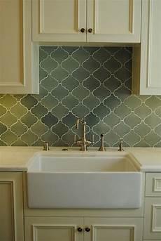 cabinets brass hardware green arabesque tile