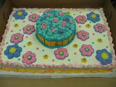 1 2 sheet cake with large flowers in buttercream icing 6 inch 1 layer cake in center