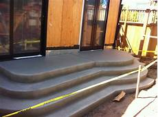 formwork for a curved concrete stair is done in one day and the finish work in another