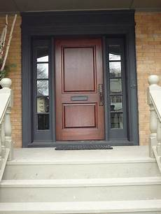 mahogany door with black sidelites and trim exterior painting ideas entry doors doors