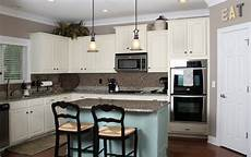 sloan chalk painted kitchen cabinets in duck egg blue and old white by tucker