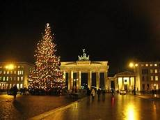 brandenburg gate and tree picture of berlin