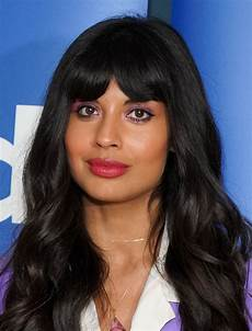 jameela jamil wavy cut with bangs hair lookbook stylebistro