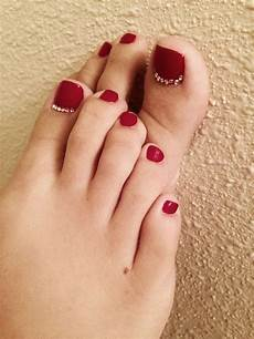 deep red toes with little rhinestones on the big toes