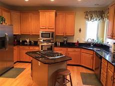 i need help with paint colors that go well with honey oak cabinets