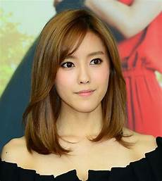 Medium Length Hairstyles With Side Swept Bangs