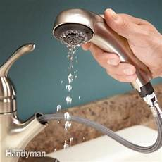 where is the aerator on a kitchen faucet running water unclog the aerator the family handyman