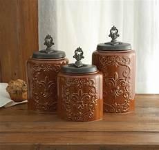 rustic kitchen canister sets antique fleur de lis brown canister set rustic kitchen