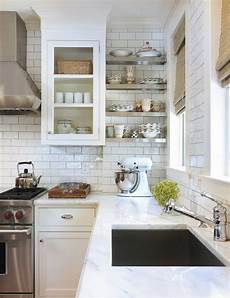 the classic of subway tile backsplash in the kitchen
