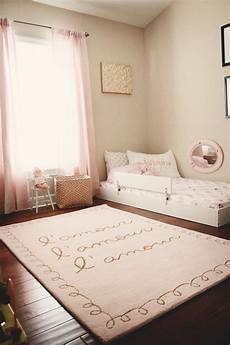 bed for toddler and baby shared nursery with parents