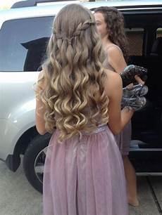 curls with a waterfall braid connecting both sides