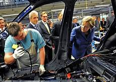 Angela Merkel Pictures Bmw To Produce Electric Cars In