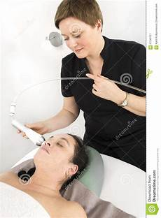 client gets face slimming treatment at clinic