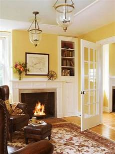 living room walls harvest gold with white trim and dark brown leather for the home in 2019