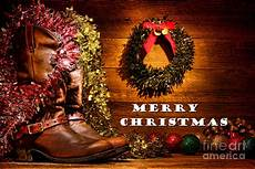 christmas cowboy boots merry christmas photograph by olivier le queinec