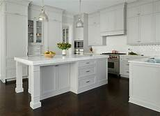 light gray painted kitchen cabinets with glossy white chevron tiles transitional kitchen