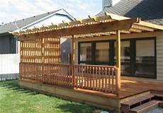 trex with half of pergola only and closed in deck deck construction decks