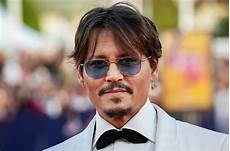 johnny depp johnny depp s libel trial gets postponed because of