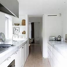 white galley kitchen with wood flooring galley kitchen