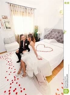 newlyweds in bedroom with heart image of