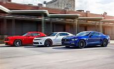 Mustang Vs Camaro - 2015 ford mustang gt vs chevrolet camaro ss 1le dodge
