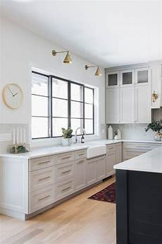 the wall paint color is sherwin williams extra white sw 7006 light grey kitchen with white walls