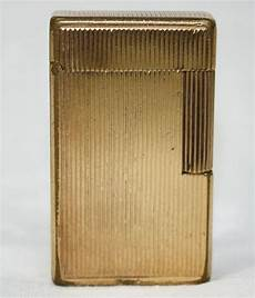 briquet dupont en plaque or poids total 9410 grammes