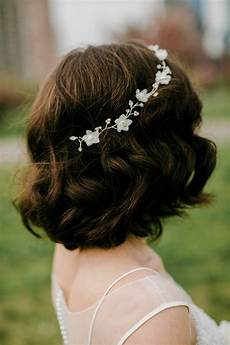 short curly bridal hairstyle with headband
