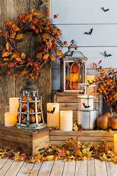 Diy Deko Herbst - fill lanterns with pumpkins and other fall pieces for an