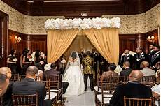 regal style mansion wedding with black and gold color