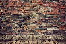 Empty Wood Floor And Brick Wall For Vintage Wallpaper