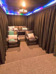 a diy home theater room hang curtains around your seats for increased darkness during the show