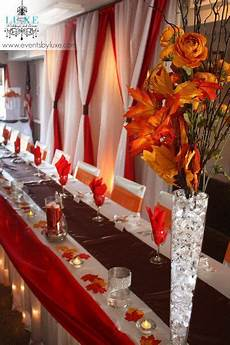 red and white and orange fall wedding backdrop and head