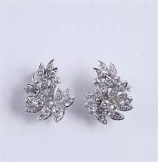 orecchini fiore orecchini con diamanti a forma di fiore argenti e
