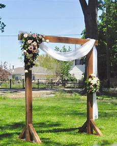 outdoor wedding ceremony arch idea wooden arch with