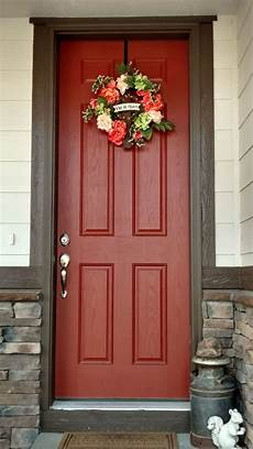 and chocolate brown house with burnt orange door and coral colored spring wreath in 2019