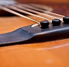 how to fix a guitar bridge how to lower the on your acoustic guitar bridge and saddle guitar repair bench