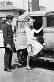 Norma Shearer Stepping Into Her Chauffeured Car Outside