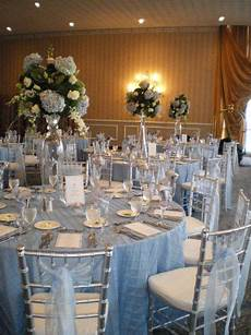 light blue wedding theme light blue table linens blue accents in the flower centerpieces and