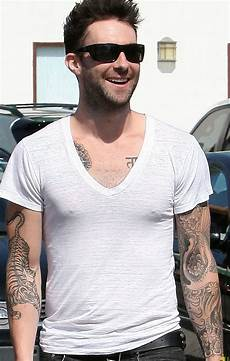 world famous celebrities adam levine and full tattoos on