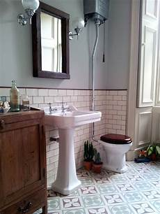 edwardian encaustic tile floor with subway tile