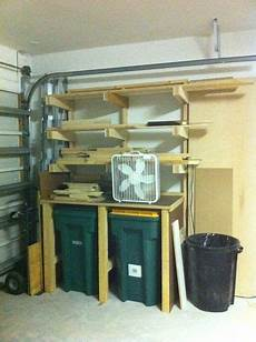 Garbage Garage Up by Lumber Storage Plus Shelf Space On Your Trash Cans