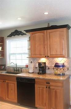 image result for black countertops with oak cabinets what accent color kitchen cabinet crown