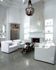 White Walls And In Floor Storage Make This Creative House Design white walls contrast with polished grey concrete floors by
