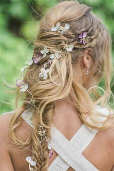 messy boho long bridal hairstyle with hydrangea