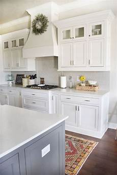 the backsplash is a light gray subway tile color is called pumice made by h line grout col